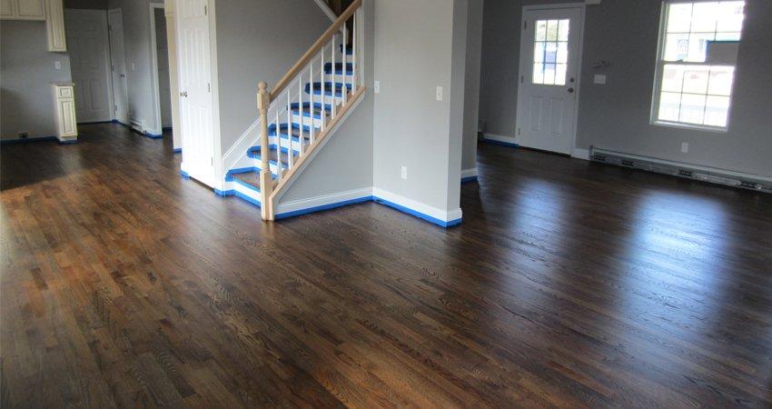 Dark-stained hardwood flooring in Toronto